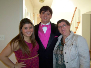 Athena, her brother Mike and mother Cathy posing before Mike's prom
